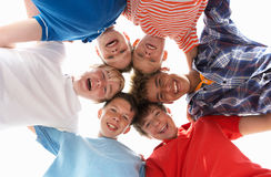Teenagers in circle. Looking at camera smiling Stock Photography