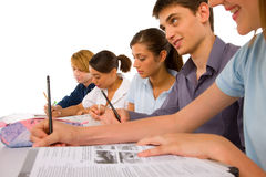 Teenagers in classroom Stock Image
