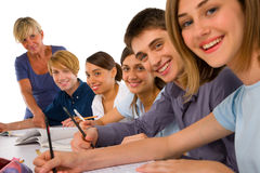 Teenagers in classroom. With teacher Stock Photos