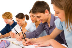 Teenagers in classroom. On white background Royalty Free Stock Image