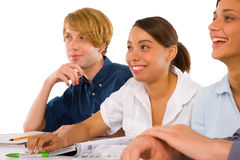 Teenagers in classroom Stock Photo