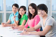 Teenagers in classroom Stock Photos