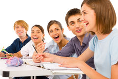 Teenagers in classroom. Happy teenagers in classroom while studying Stock Photos