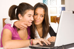 Teenagers with computer Stock Images