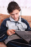 Teenagers and computer. Laptop and headphones for the new generations Royalty Free Stock Photo