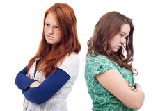 Teenagers conflict. Two young teenager girls in conflict - isolated Royalty Free Stock Images
