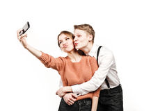 Teenagers couple making selfie by smartphone Stock Images