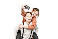 Teenagers couple making selfie by smartphone Royalty Free Stock Photo