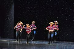 Teenagers cowboys dancing. The Dance Connection, New Jersey, dance school students performing a show for guests onboard cruise ship Adventure of the Seas stock photography