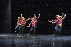 Teenagers cowboys dancing. The Dance Connection, New Jersey, dance school students performing a show for guests onboard cruise ship Adventure of the Seas stock images