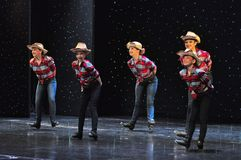 Teenagers cowboys dancing. The Dance Connection, New Jersey, dance school students performing a show for guests onboard cruise ship Adventure of the Seas royalty free stock image
