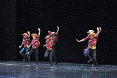 Teenagers cowboys dancing. The Dance Connection, New Jersey, dance school students performing a show for guests onboard cruise ship Adventure of the Seas royalty free stock photography