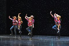 Teenagers cowboys dancing. The Dance Connection, New Jersey, dance school students performing a show for guests onboard cruise ship Adventure of the Seas stock photos