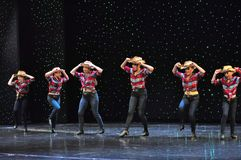 Teenagers cowboys dancing. The Dance Connection, New Jersey, dance school students performing a show for guests onboard cruise ship Adventure of the Seas royalty free stock photos