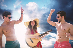 Composite image of teenagers dancing and playing music Stock Image