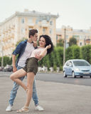Teenagers on a date. The guy and the girl dancing in the street. Love and romance. Flirting. The first relationship. City life. Street fashion Stock Photos