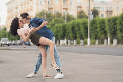 Teenagers on a date. The guy and the girl dancing in the street. A passionate kiss. Love and romance. Flirting. The first relationship. City life. Street Stock Photography
