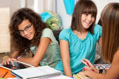 Teenagers discussing their homework. Royalty Free Stock Images