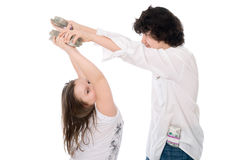 Teenagers divide money Stock Photo