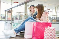 Teenagers do shopping online at retail stock photography
