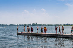 Teenagers on a dock Stock Photo