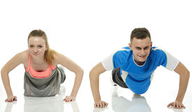 Teenagers doing pushups Stock Image
