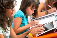 Teenagers doing schoolwork. stock photography