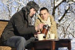 Teenagers drinking tea Stock Image