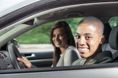 Teenagers driving car Stock Photography