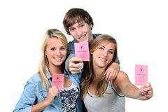 Teenagers with driving licences Stock Photo