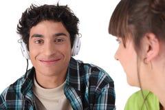 Teenagers with eadphones Stock Image