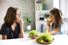 Teenagers eat fresh organic grapes Royalty Free Stock Images