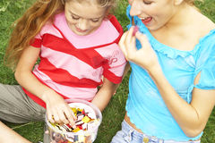Teenagers eating candy. Stock Photography