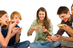 Teenagers eating pizza. On white background Stock Photos