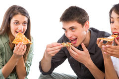Teenagers eating pizza. On white background Stock Images
