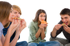 Teenagers eating pizza. On white background Stock Image