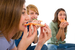 Teenagers eating pizza Royalty Free Stock Image
