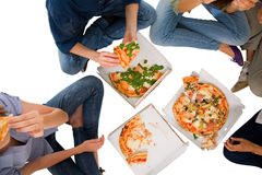 Teenagers eating pizza Royalty Free Stock Photos
