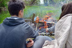 Teenagers enjoying  barbecue outdoors Royalty Free Stock Photo