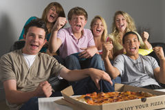 Teenagers Enjoying Drinks Together Stock Photography
