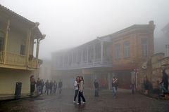 Teenagers are on the excursion in Sighnaghi in foggy weather, Georgia Stock Photos