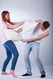Teenagers fighting with pillows Stock Photo