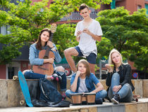 Teenagers friends with musical instruments Royalty Free Stock Image