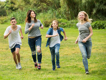 Teenagers friends running on meadow Royalty Free Stock Image