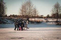 Teenagers frolic on the ice, winter fun girl skating. Teenagers frolic on the ice at sunset, winter fun girl skating Stock Image