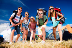 Teenagers in front of tents with backpacks, summer festival Royalty Free Stock Photos