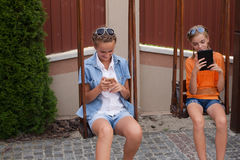 Teenagers with gadgets Stock Photos