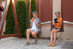 Teenagers with gadgets Royalty Free Stock Photos