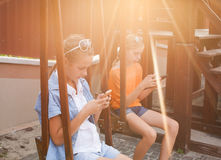 Teenagers with gadgets Stock Images