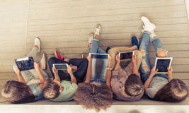 Teenagers with gadgets Royalty Free Stock Photography